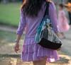 Beautiful light purple dress at Lumphini Park, Bangkok, Thailand in December 2009