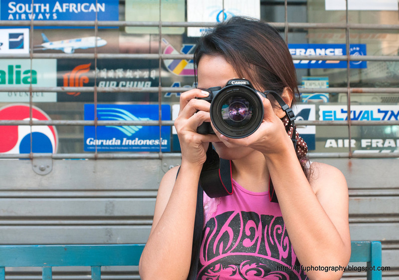 Fon taking a photo in Silom, Bangkok, in December 2009