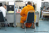 A monk at a police station in Bangkok in March 2010