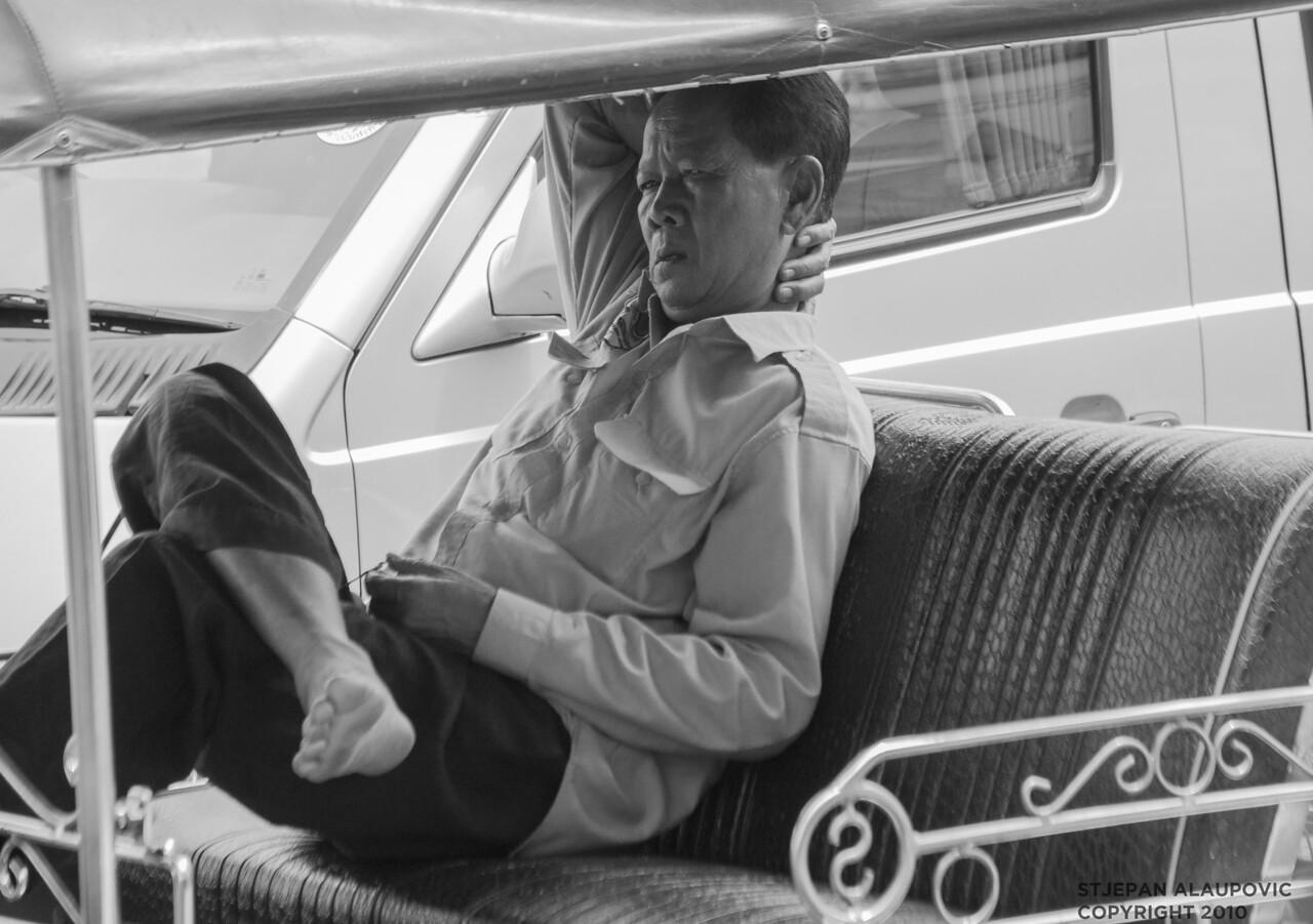 Thai Taxi Driver on Break