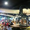 Seating Area with Giant Killer Crab Statue, Terminal 21 Food Court, Bangkok