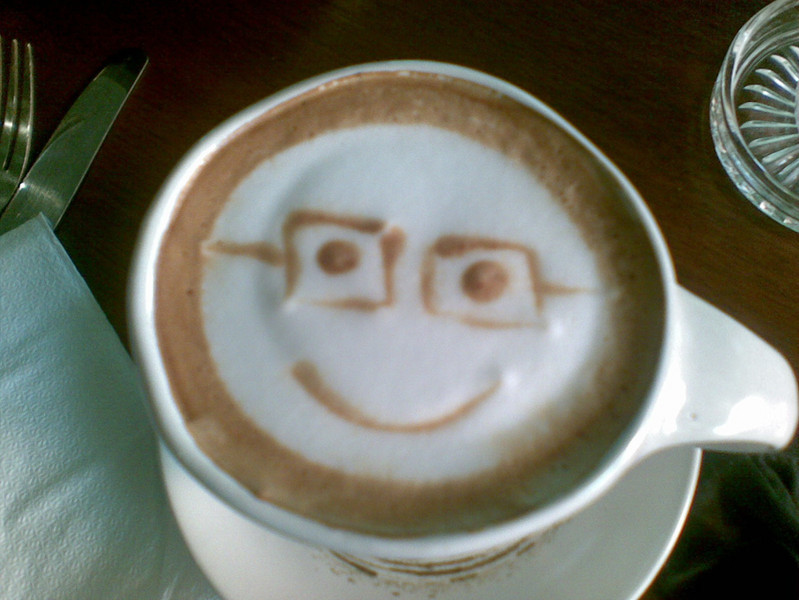 A cafe latte at Bitter Brown arrives with a smile