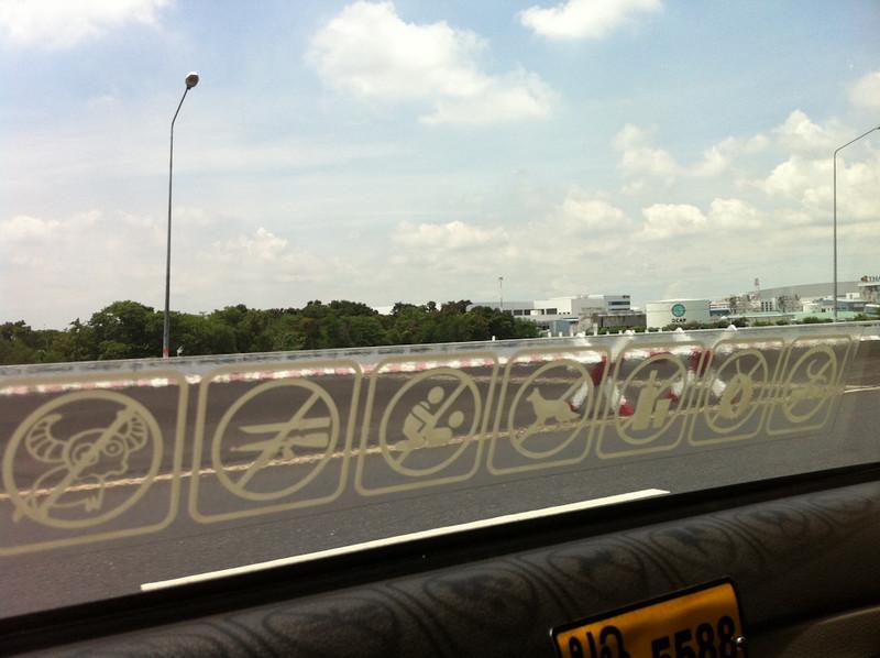 Bangkok Taxi's comprehensive sign list of forbidden behaviour on the back seat