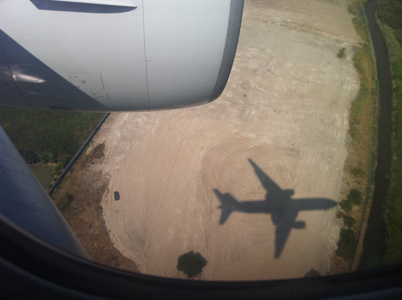 The shadow of a jumbo jet coming in to land at Bangkok Airport