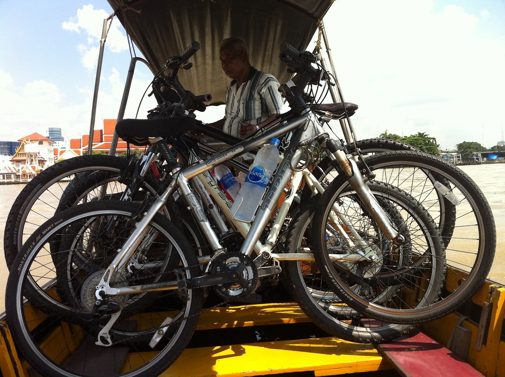 Stacking the bikes on the long tail boat for the river crossing