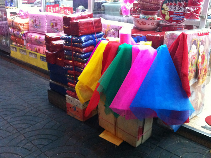 Brightly coloured cloths for sale in Bangkok's Chinatown