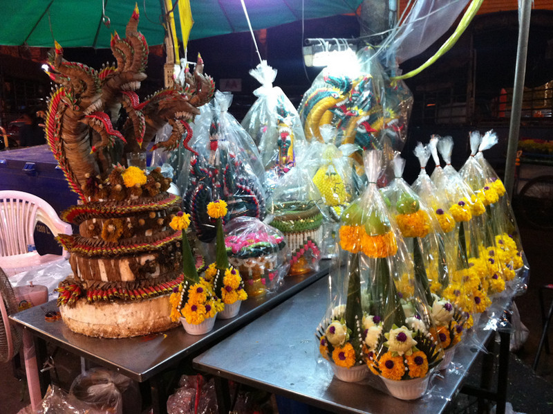 Fearsome Naga (Guardian Snakes) made from reeds and flowers at Bangkok flower market