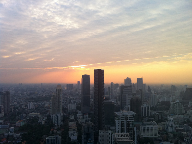 Sun goes down over the Bangkok business district of Silom