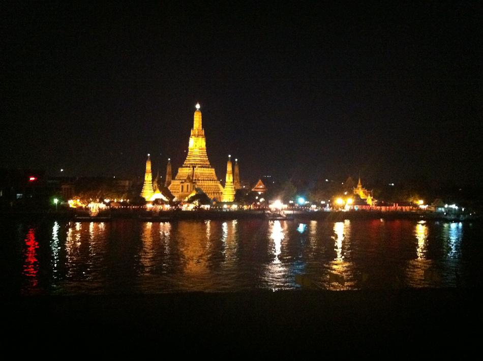 Wat Arun (the Temple of the Dawn) at night on the Chao Phraya River, Bangkok