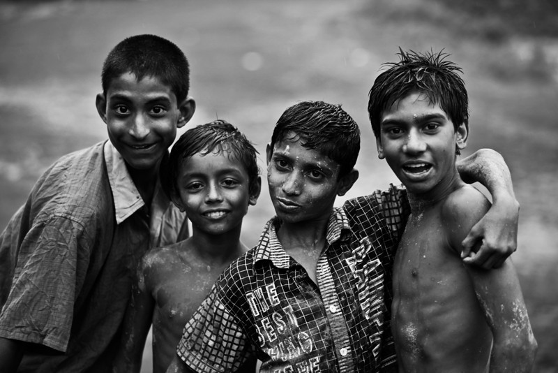Boys playing football in the rain in Jessore.