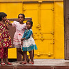 Girls playing in Dhaka. It is a public holiday and they are dressed up.