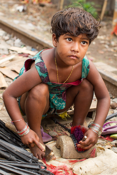 A girl who together with her mother and elder sister make toilet cleaners. They live next to the railway track in Saidabad in Dhaka city.