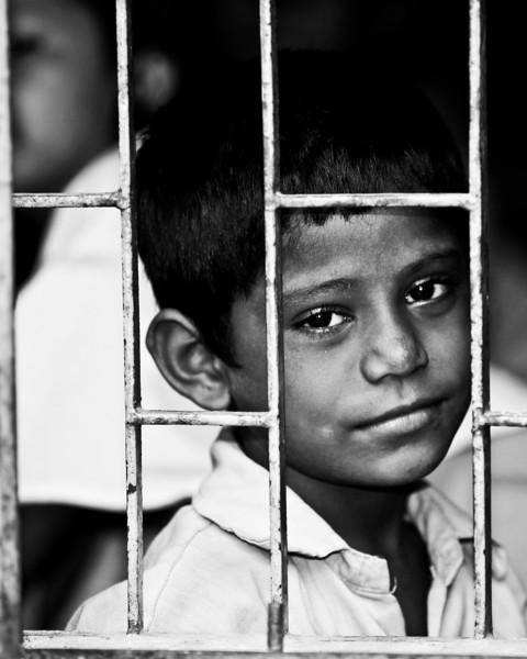 A boy attending class in a school outside Dhaka