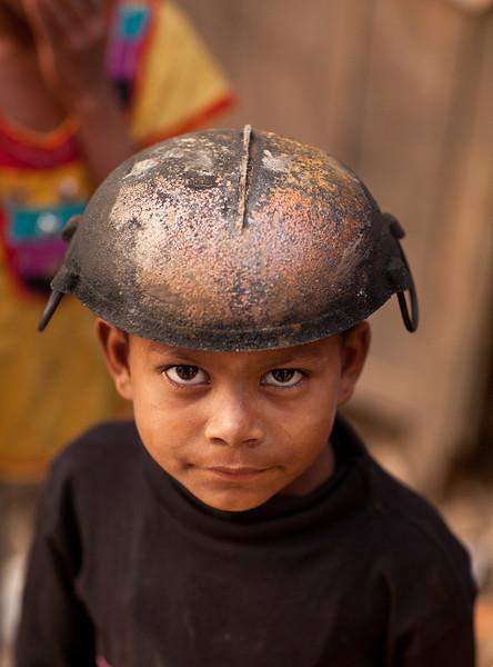 Boy with iron pot.