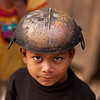 Boy with iron pot.