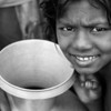 A girl who is waiting hours for drinking water in Dhaka city.