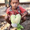 A boy with his teddy bear. He lives in a slum along the tracks in Saidabad, one of the toughest areas of Dhaka city.