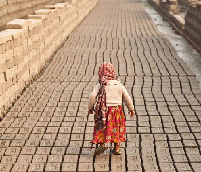 A girl who lives on a brick kiln site, where her father and mother work. Her world is the brick kiln site.