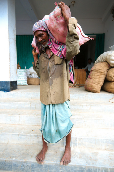 We saw this porter carry huge bags of potatoes up and down the stairs to leading to the river, he was very keen for us to take a photo of him WITH the potato bag on his shoulders