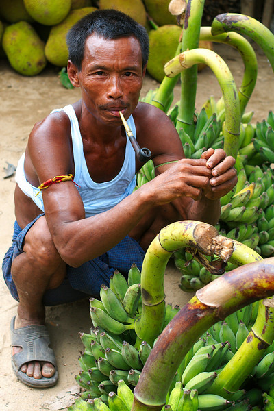 Banana seller taking a pipe break