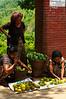 Local women selling mangoes near the waterfall