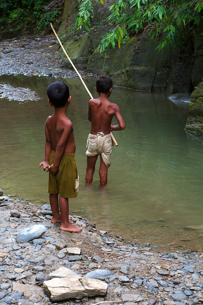 Boys fishing in the river near Hafeez Ghona