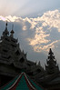 The sun peaks through the clouds at Bana Vihara, the Buddhist temple complex