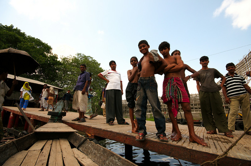 Locals watch us board the river taxi