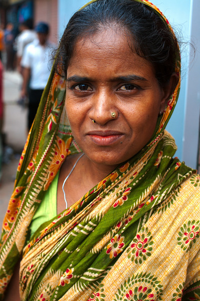A woman poses near the Chittagong Market