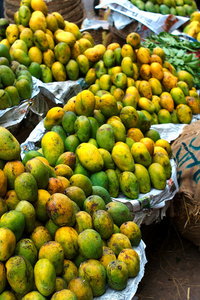 Mangoes for sale on the side of the street