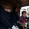 A boy with his mother and another woman in a rickshaw in Teknaf.