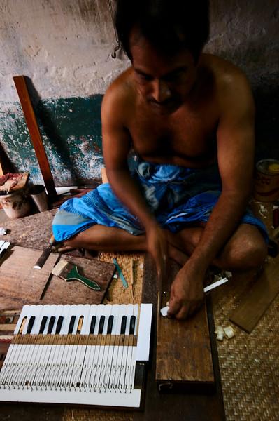 Making a harmonium in a small shop on Hindu St.