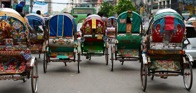 Rickshaws race through the streets of Dhaka