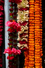 Flower garlands hang at a Hindu St. shop