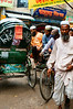 Rickshaws and pedestrians jostle for space in Old Dhaka