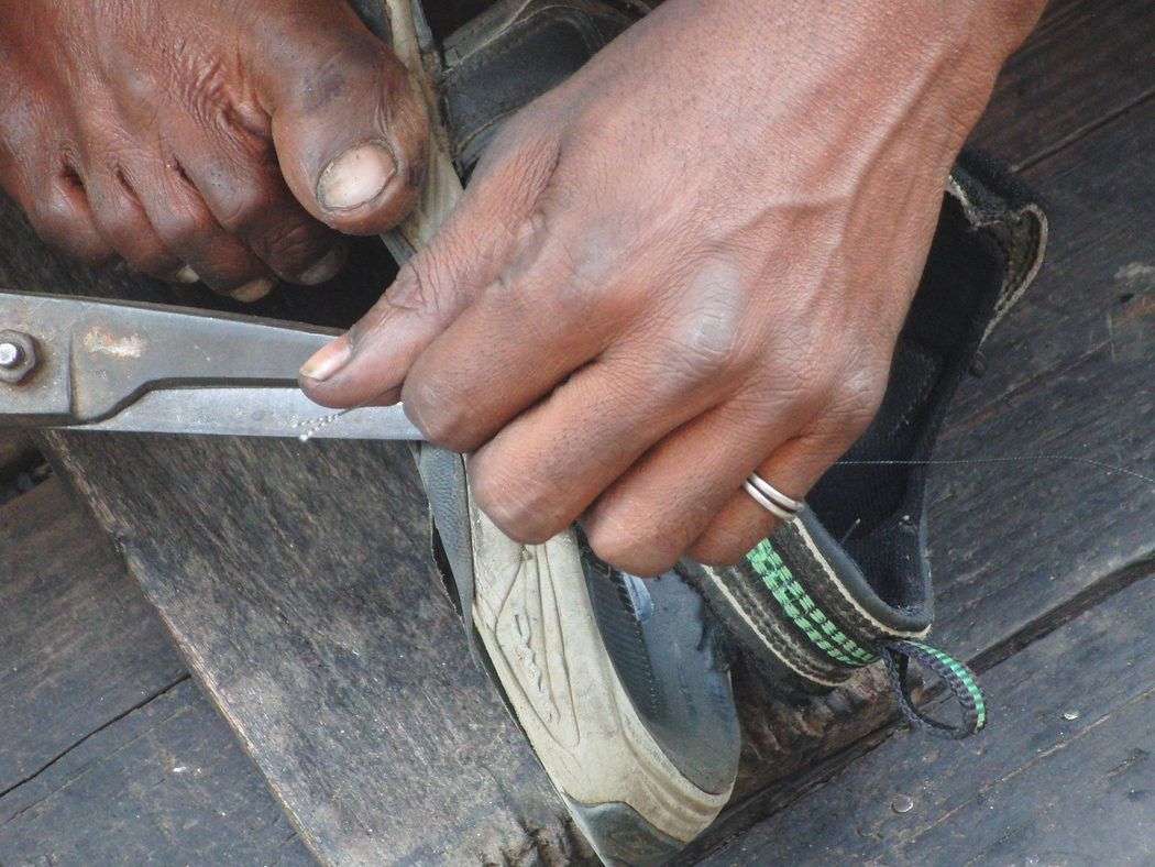 Sandal Repair on the streets of Old Dhaka, Bangladesh