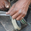 "A street shoe repairman doctors up my sandals in Dhaka, Bangladesh.  This is a travel photo from Old Dhaka, Bangladesh. <a href=""http://nomadicsamuel.com"">http://nomadicsamuel.com</a>"