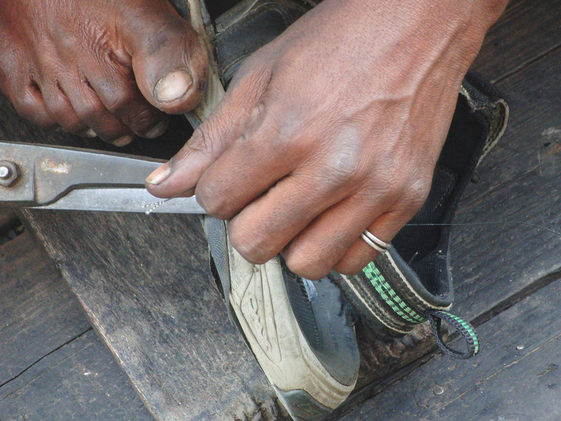 """A street shoe repairman doctors up my sandals in Dhaka, Bangladesh.  This is a travel photo from Old Dhaka, Bangladesh. <a href=""""http://nomadicsamuel.com"""">http://nomadicsamuel.com</a>"""