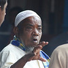 "A man with a distinct facial expression candidly interacts with others - Dhaka, Bangladesh.  Travel photo from Dhaka, Bangladesh. <a href=""http://nomadicsamuel.com"">http://nomadicsamuel.com</a>"