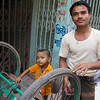 "A Bangladeshi father and his cute son repair a rickshaw wheel - Old Dhaka, Bangladesh.  This is a travel photo from Old Dhaka, Bangladesh. <a href=""http://nomadicsamuel.com"">http://nomadicsamuel.com</a>"