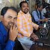"A photo of smiling Bangladeshi men working with sewing machines - Dhaka, Bangladesh.  Travel photo from Dhaka, Bangladesh. <a href=""http://nomadicsamuel.com"">http://nomadicsamuel.com</a>"