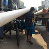 "A man hauls a long pipe on the streets of Old Dhaka - Dhaka, Bangladesh.  This is a travel photo from Dhaka, Bangladesh. <a href=""http://nomadicsamuel.com"">http://nomadicsamuel.com</a>"