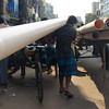 "A man hauls a long pipe on the streets of Old Dhaka - Dhaka, Bangladesh.  This is a travel photo from Dhaka, Bangladesh. <a href=""http://nomadicsamuel.com"">http://nomadicsamuel.com</a>"