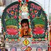 A boy in a rickshaw.
