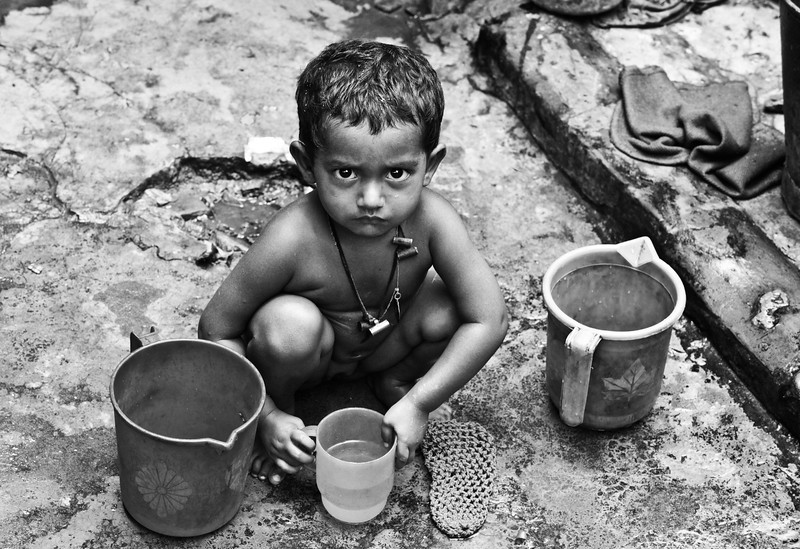 A girl washing on a Friday morning. She lives in a slum in Dhaka.