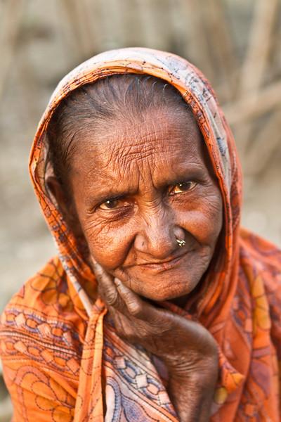 An elderly woman in a slum.