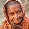 An elderly woman in a slum.