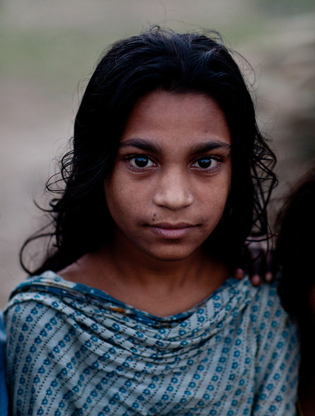 A girl in slum along the Buriganga river in Dhaka - one of the most polluted areas in the country.