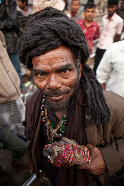 The Mystic Man with the magic stick. A slum in Dhaka city.