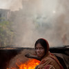 Female road worker. She was laying asphalt in Banani, one of the wealthy areas of Dhaka.